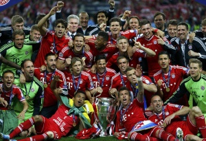The Bayern Munich squad pose with the trophy after defeating Borussia Dortmund in their Champions League Final soccer match at Wembley Stadium in London